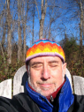 David outdoors eyes closed, wearing colorful hat, 12/12/2009